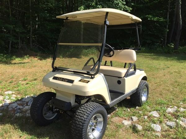 2010 Club Car DS electric 4 passenger golf cart with lift kit