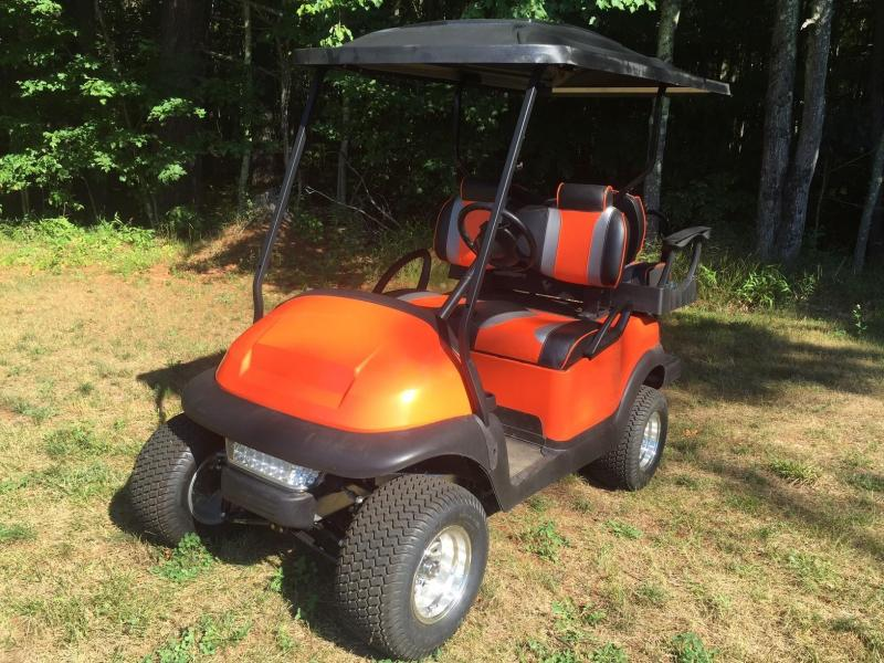 Custom Precedent Orange-Black 4 pass elec lifted golf cart