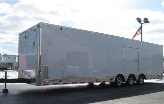 <b>CALL FOR PRICE</b> 32' Millennium Auto Master Tri Axle Enclosed Trailer Red Cabinets