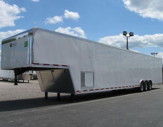 2016 48' Millennium Trailers Silver Enclosed Gooseneck Trailer