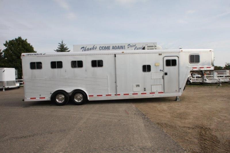 2000 Featherlite 4 horse with 9' LQ with Slide Out