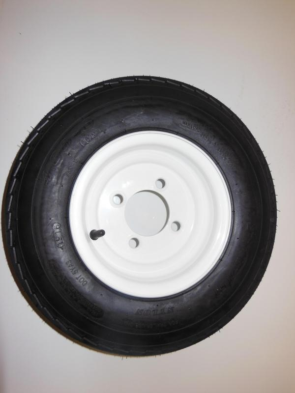 4.80 - 8 TIRE ON A WHITE 4LUG RIM