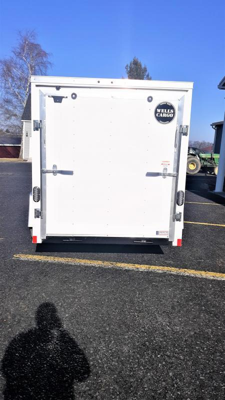 "Wells Cargo FastTrac Single Axle Enclosed 6x12 2990 GVWR -Ramp Door -V-Nose -White Color -32"" Side Door -6' Inside Height -1-3.5K Idler Axle -15"" Radial Tires"