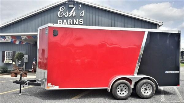 "Wells Cargo Road Force Tandem Axle Enclosed 7'x16' 7K -Black/ Victory Red -Ramp Door -Side Door -V-Nose -6'6"" Inside Height - Screwless Exterior -15"" Radial Tires"