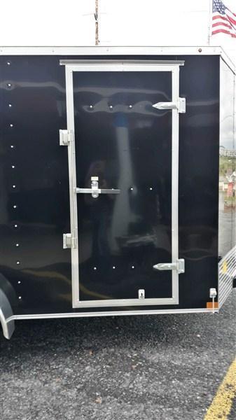"""Wells Cargo FastTracTandem Axle Enclosed 7'x14' 7K -Black -Ramp Door -Side Door -V-Nose -6'6"""" Inside Height - Screw Pattern Exterior -15"""" Radial Tires"""