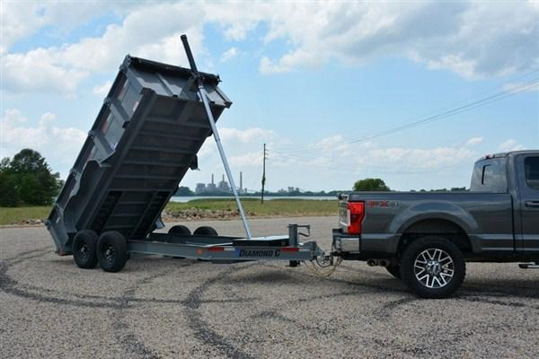"Diamond C Low Profile Telescopic Dump Trailer 14'x82"" 14.9K -8"" I-Beam Frame -12K Drop Leg Jack -Spare Mount -36"" Side Step -20' Tarp Installed -7,000# Straight Axles -16"" Radial Tires"
