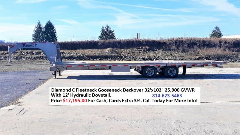 "Diamond C Deckover Gooseneck 102""x32' 25.9K -12' Hydraulic Dovetail -16"" Engineered Beam Frame -12"" Engineered Neck -12,000# Oil Bathe Axles -HDSS Suspension -16"" Dual Nitrogen Filled Radial Tires"
