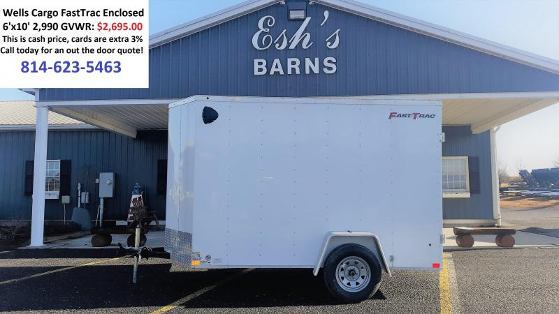 "Wells Cargo FastTrac Single Axle Enclosed 6'x10' 2990 GVWR -White -V-Nose -Double Doors -Steel Frame -6'6"" Inside Height - 1- 3.5K No Brake Axle -32""x72"" Side Door -15"" Radial Tires"