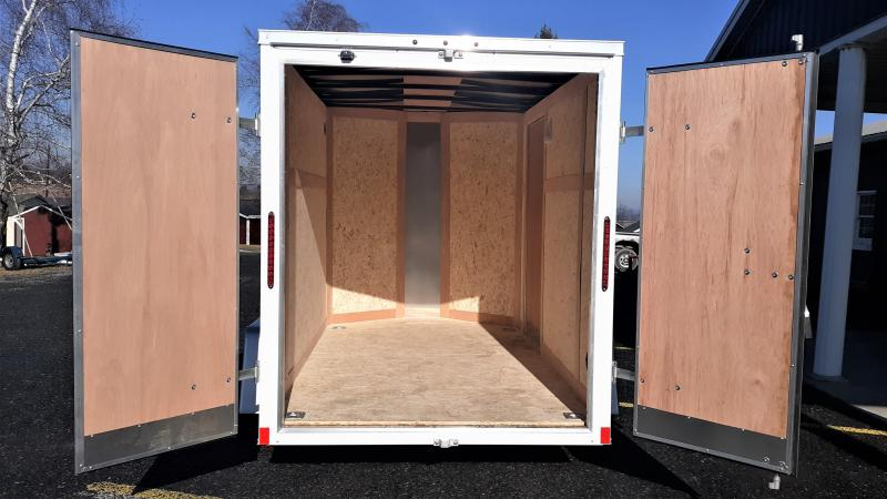 """Wells Cargo FastTrac Single Axle Enclosed 6'x10' 2990 GVWR -White -V-Nose -Double Doors -Steel Frame -6'6"""" Inside Height - 1- 3.5K No Brake Axle -32""""x72"""" Side Door -15"""" Radial Tires"""