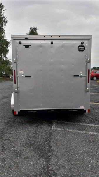 "Wells Cargo FastTrac Tandem Axle Enclosed 7'x14' 7K -Silverfrost -Ramp Door -Side Door -V-Nose -6'6"" Inside Height - Screw Pattern Exterior -15"" Radial Tires"