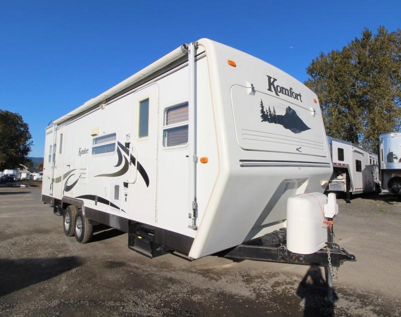 2007 Komfort 274TS - 27ft Travel Trailer w/ 2 Slide outs - Dinette and couch - Flip up Counter extension - Full sized bed