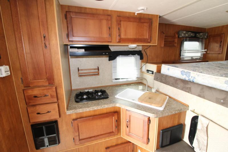 2015 Northland Yukon Truck Bed Camper - Slide out - Bedside Counters w/ Storage -  RV Roof Vents and Covers - Dinette - Large Fridge/Freezer