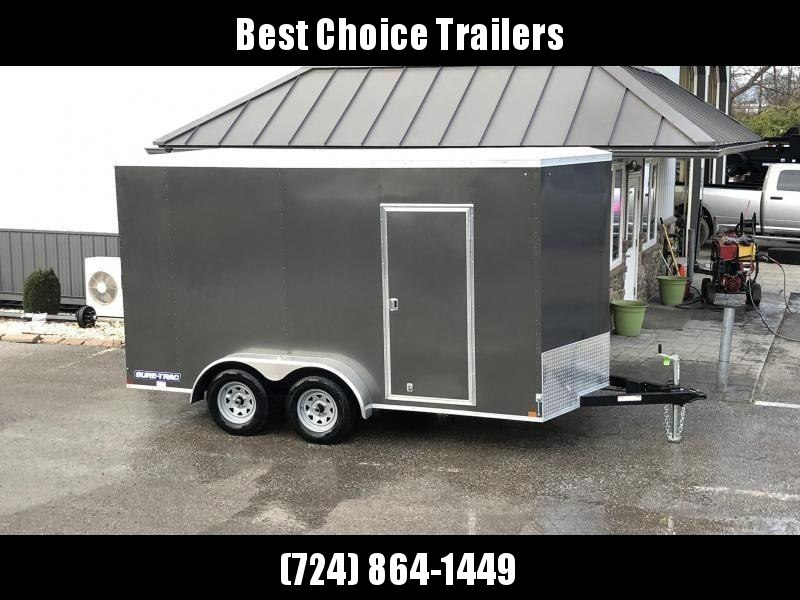 "2020 Sure-Trac 7x14' Enclosed Cargo Trailer 7000# GVW * CHARCOAL EXTERIOR * V-NOSE * RAMP * +12"" HEIGHT (7') * 4 D-RINGS * HEAVY WALL FRAME * LOADING LIGHT * STABILIZER JACKS * BEAVERTAIL * UTV PACKAGE * .030 SEMI-SCREWLESS EXTERIOR * TUBE STUDS * RV DOOR"