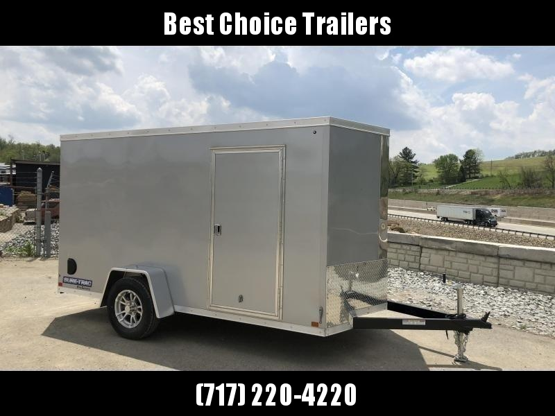"2020 Sure-Trac 6x10' Pro Series Enclosed Cargo Trailer 2990# GVW * SILVER EXTERIOR * V-NOSE * RAMP * .030 SCREWLESS EXTERIOR * ALUMINUM WHEELS * 1 PC ROOF * 4"" TUBE FRAME * 16"" O.C. WALLS * PLYWOOD * TUBE STUDS * CEILING LINER * RV DOOR"