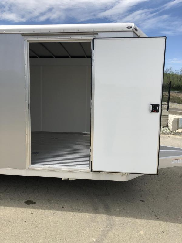 2019 NEO Trailers NACX2485R Liberator Enclosed Car Trailer 9990# GVW SILVER * FULL ESCAPE DOOR * EXTRUDED ALUMINUM FLOOR/RAMP * 5200# TORSION * BULLNOSE * SPREAD AXLE * DRT REAR SPOILER * NXP RAMP * CLEARANCE