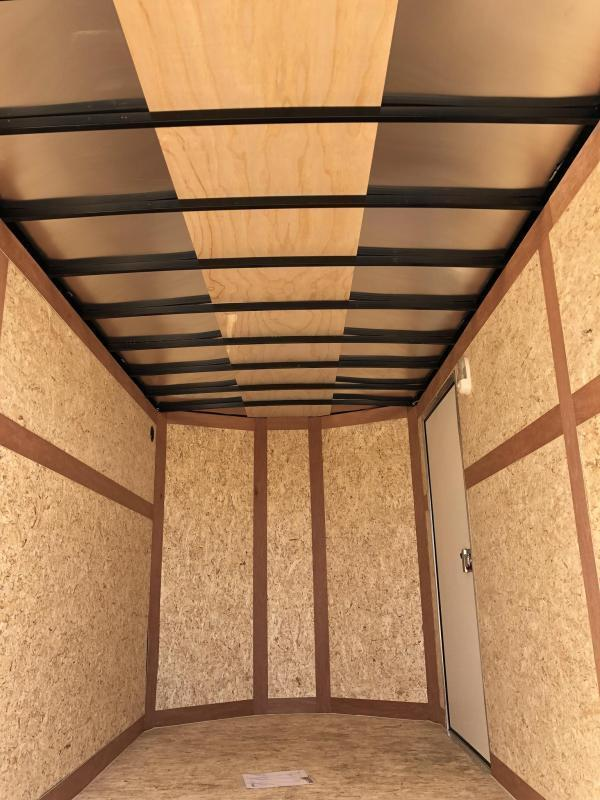 "2020 Wells Cargo 6x12' Road Force Enclosed Cargo Trailer 2990# GVW * SILVER EXTERIOR * RAMP DOOR * SCREWLESS .030 EXTERIOR * 1PC ALUM ROOF * 6'6"" HEIGHT * TUBE STUDS * 16"" O.C WALLS * ARMOR GUARD TONGUE"