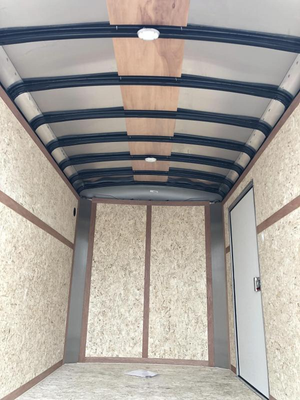 "2020 Wells Cargo 6x10' Road Force Enclosed Cargo Trailer 2990# GVW * WHITE EXTERIOR * ROUND TOP * RAMP DOOR * .030 EXTERIOR * 1PC ALUM ROOF * 6'6"" HEIGHT * TUBE STUDS * 16"" O.C WALLS"