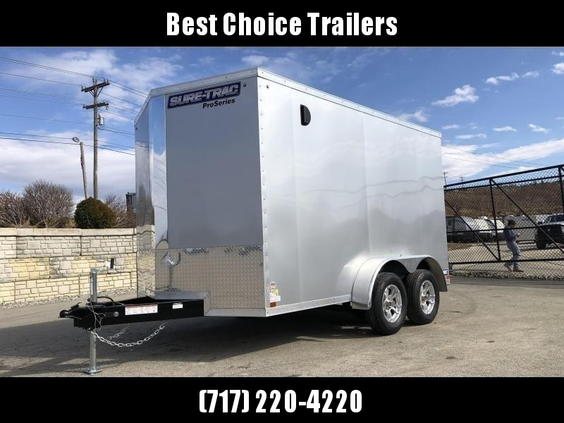 """2019 Sure-Trac 7x14' Pro Series Enclosed Cargo Trailer 7000# GVW * SILVER EXTERIOR * V-NOSE * RAMP * .030 SCREWLESS EXTERIOR * ALUMINUM WHEELS * 1 PC ROOF * 6'6"""" HEIGHT * 6"""" FRAME * 16"""" O.C. C/M * PLYWOOD * TUBE STUDS * CLEARANCE"""