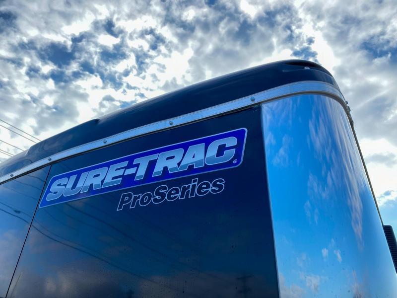 "2020 Sure-Trac 7x16' Pro Series Enclosed Cargo Trailer 7000# GVW * BLACK EXTERIOR * .030 SCREWLESS EXTERIOR * ROUND TOP * ALUMINUM WHEELS * 1 PC ROOF * 6'6"" HEIGHT * 6"" FRAME * 16"" O.C. C/M * PLYWOOD * TUBE STUDS"