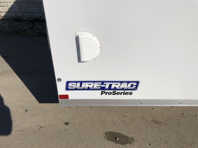 "2020 Sure-Trac 8.5x20' Pro Series Enclosed Car Hauler Trailer 9900# GVW * WHITE EXTERIOR * V-NOSE * RAMP * 5200# AXLES * .030 SCREWLESS EXTERIOR * ALUMINUM WHEELS * 1 PC ROOF * 6"" FRAME * 16"" O.C. C/M * PLYWOOD * TUBE STUDS * 48"" RV DOOR * 7K DROP JACK"