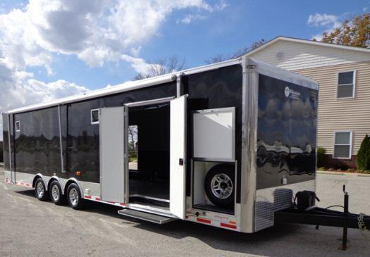 32' Millennium Auto Master Triaxle with Awning & Exterior Spare Tire Carrier