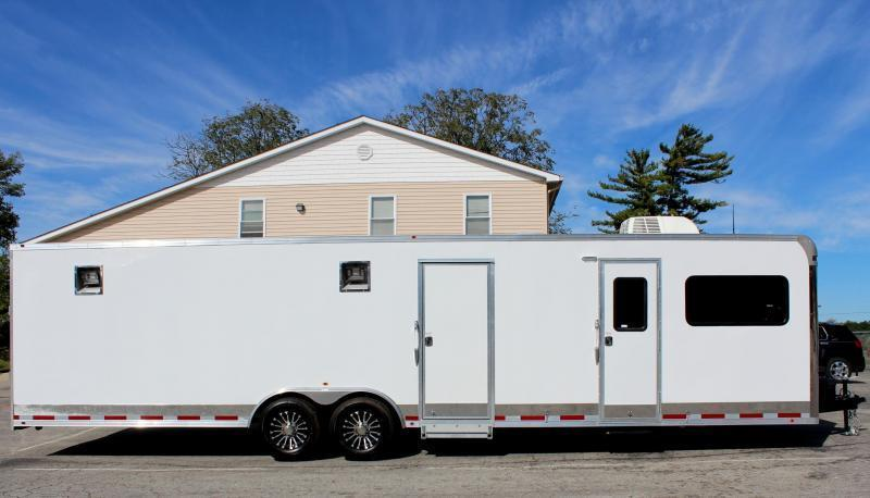 <b>Reduced Save $5207 OFF MSRP</b>  White 2019 Millennium 32' 12'XE Living Quarters  20' Cargo Area