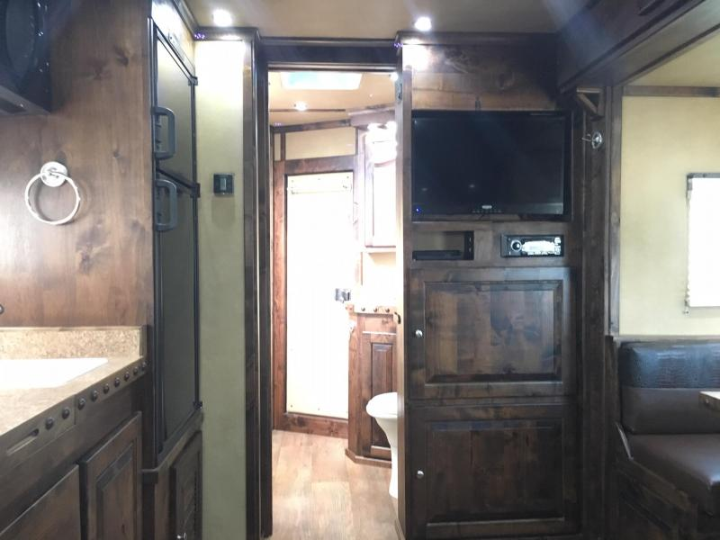 2020 Logan Coach 4 Horse Side Load with a 14 ft Short Wall Horse Trailer